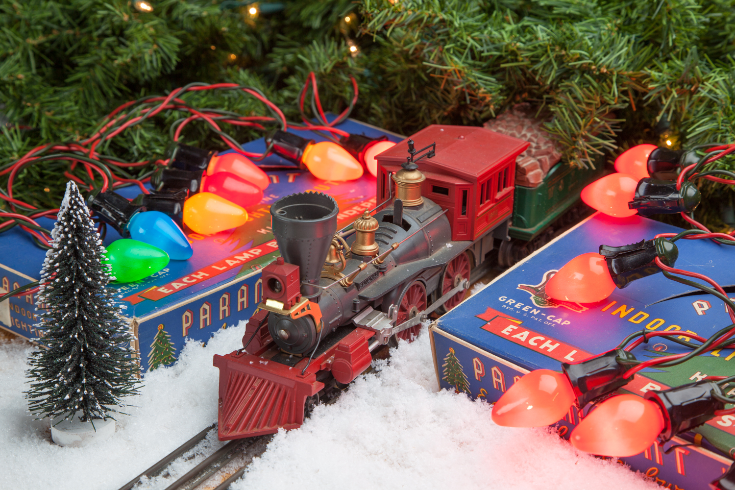 Photograph of toy train and light product packages