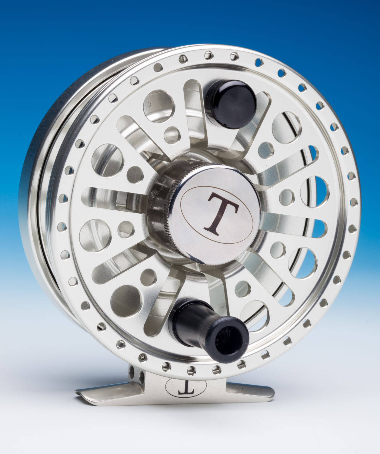 Fishing reel photograph on white and blue background.
