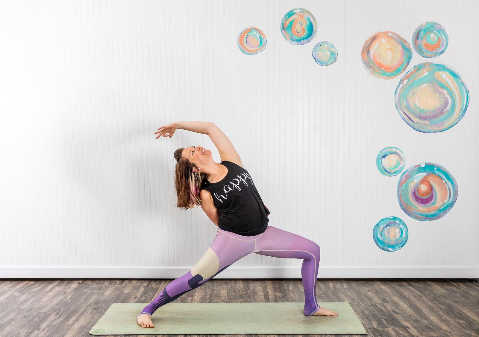 Editorial lifestyle photograph of yoga instructor